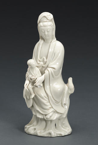A blanc de Chine figure of Guanyin and child