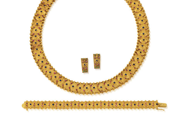 An eighteen karat gold and gem-set suite