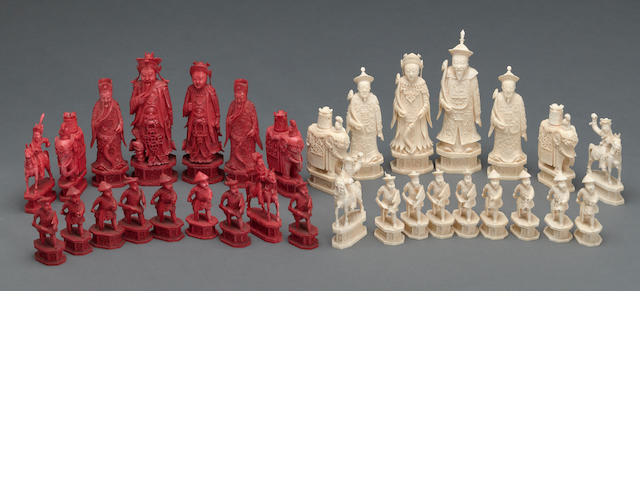 A Chinese export tinted ivory chess set with king and queen in Qing imperial court costume
