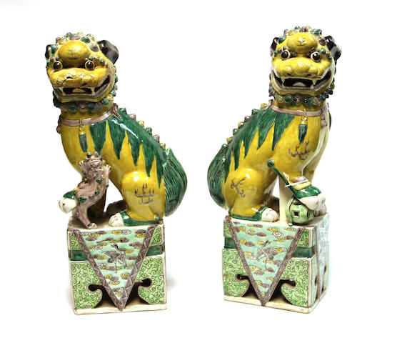 A pair of famille verte enameled porcelain lion dogs Late Qing/Republic period,