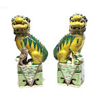 A pair of famille verte enameled porcelain lion dogs Late Qing/Republic period