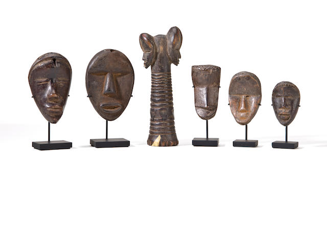 Five Dan Passport Masks and a Janus Implement, Liberia/Ivory Coast