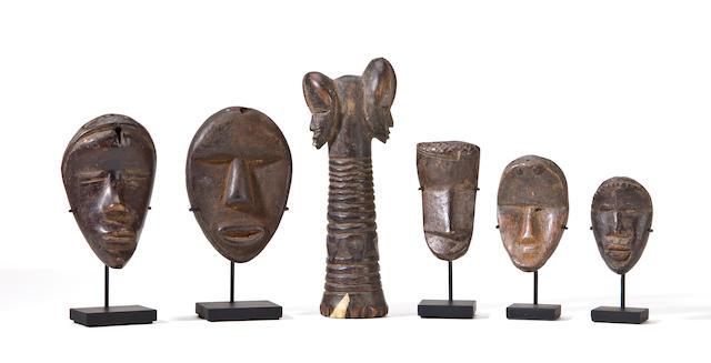 Five Dan Passport Masks and a Janus Implement, Liberia/Ivory Coast
