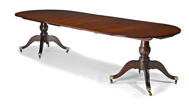 A Regency style mahogany double pedestal banquet table<br>19th century and later