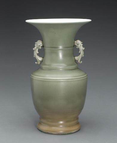A celadon glazed porcelain handled baluster vase