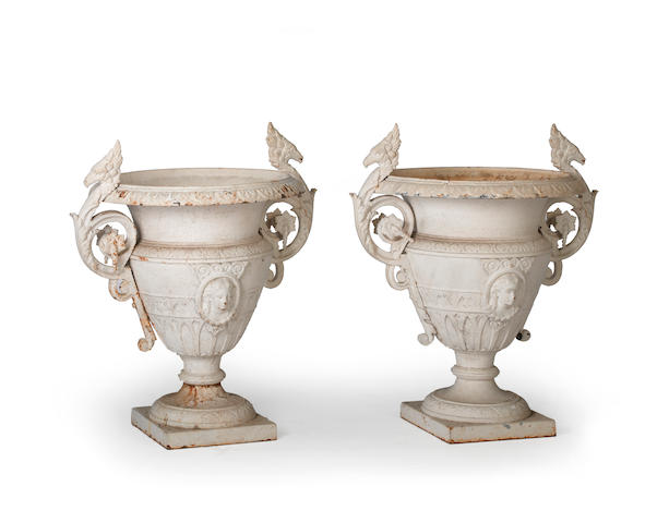 A pair of French Neoclassical style painted cast iron garden urns  second half 19th century