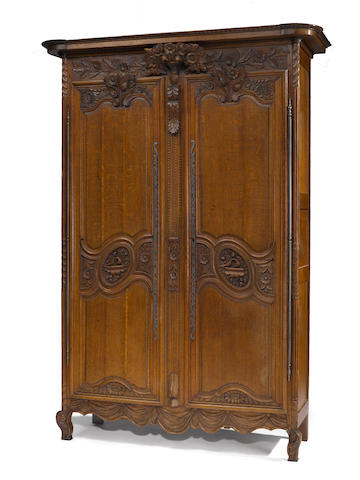 A Louis XV oak armoire third quarter 18th century