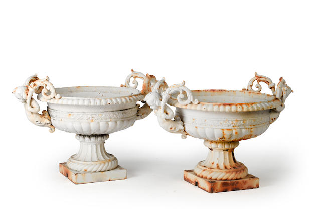 A pair of French cast iron garden urns