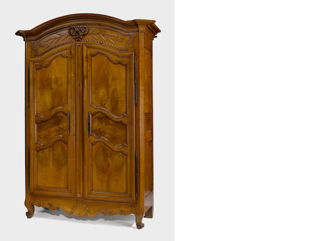 A Louis XV walnut armoire <br> third quarter 18th century