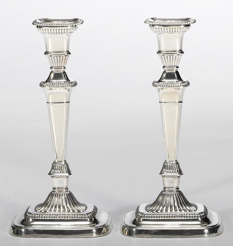 A pair of George III style silver plate candlesticks