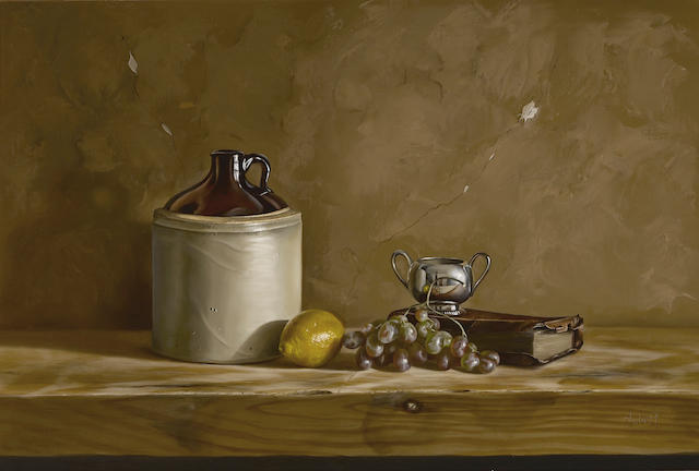 William Acheff (American, born 1947) Still life with grapes, a lemon, a ceramic jug and a book 24 1/4 x 36 1/4in