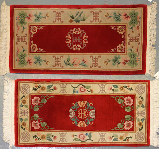 A Pair of Chinese rugs Size approximately 2ft. 1in. x 4ft. 2in. each