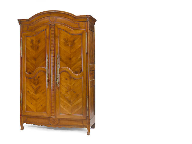 A Louis XV fruitwood armoire <br>late 18th century