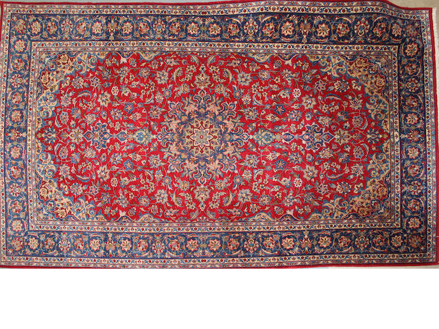 A Najf Abad carpet size approximately 7ft. 2in. x 12ft.