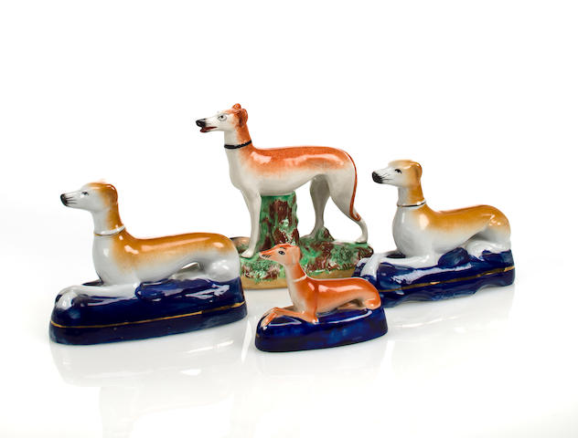 Four glazed ceramic Staffordshire style hounds  20th century 7 x 7in (17.8 x 17.8cm) the largest.