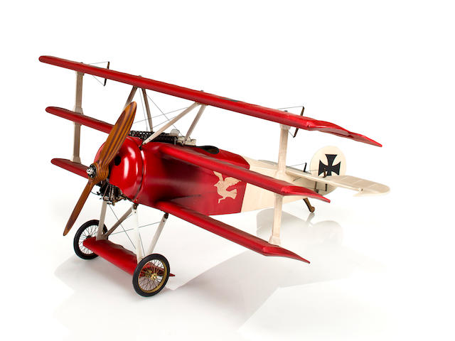 A model of a World War I Fokker Triplane  26 x 32 in. (66 x 81.3 cm.)