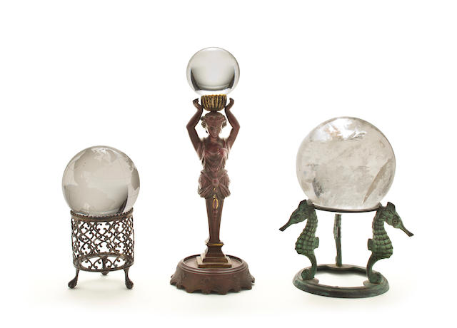 A group of three crystal balls  10 in. (25.4 cm.) the height of the tallest. 3