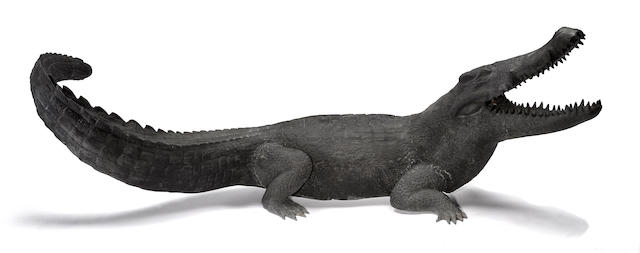 An imposing patinated bronze figure of a crocodile