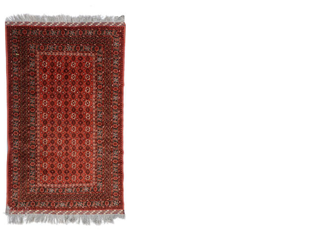 An Afghan carpet size approximately 8ft. x 10ft.