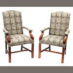 A pair of George III style library armchairs