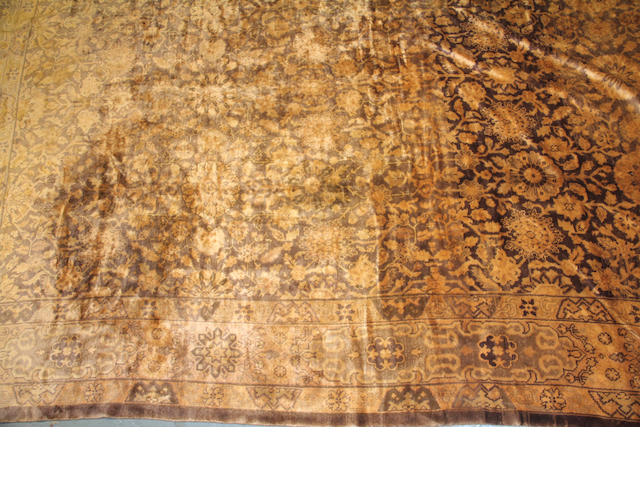 An Oushak carpet size approximately 11ft. 2in. x 18ft. 4in.