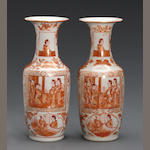 A pair of iron red enameled and gilt porcelain vases