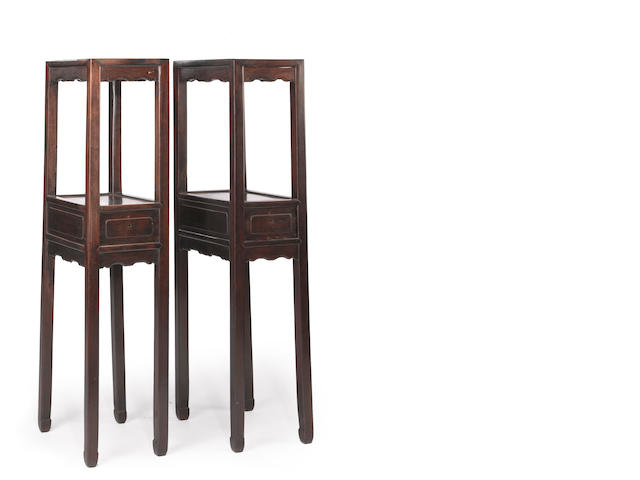 A pair of tall two-tiered hardwood stands