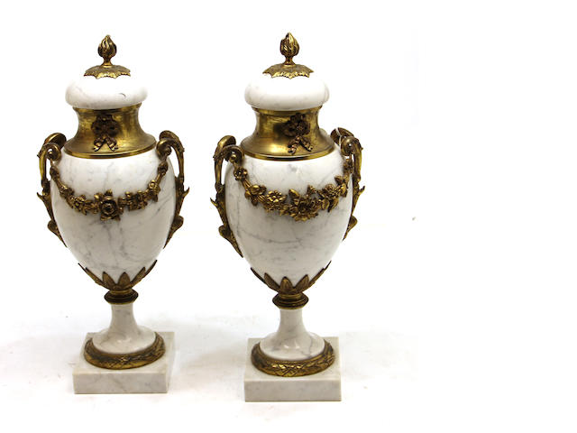 A pair of Neoclassical style gilt bronze mounted marble urns