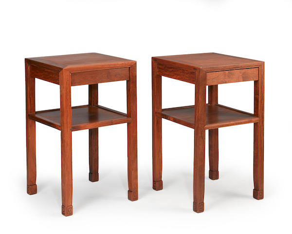 A pair of hardwood side tables