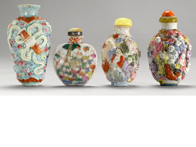 A group of four molded porcelain snuff bottles with famille rose  enamel decoration Qianlong marks, 1820-1900