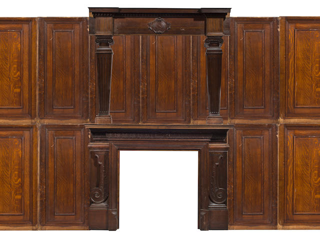 A Victorian carved oak fireplace mantel and suite of paneling dated 1897
