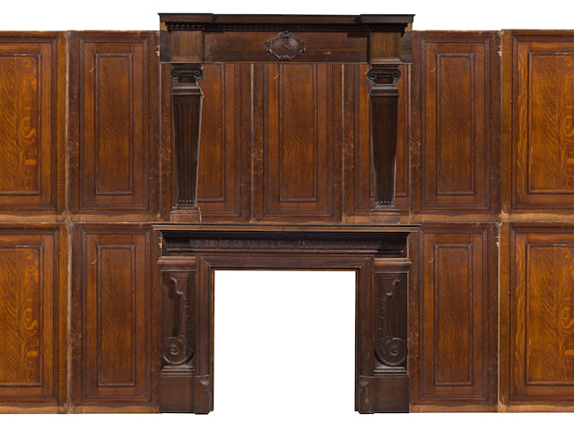 A Victorian carved oak fireplace mantel and suite of paneling<br>dated 1897