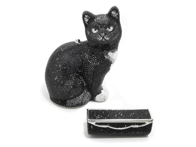 A black and silver crystal cat minaudiere together with a black crystal lipstick holder,