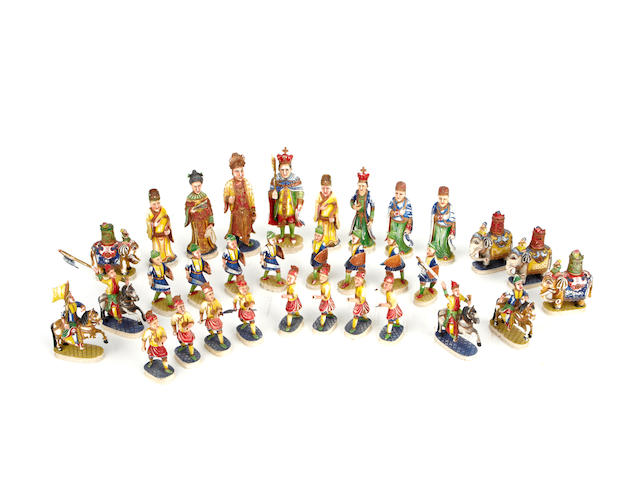 A Chinese Export carved ivory polychromed chess set