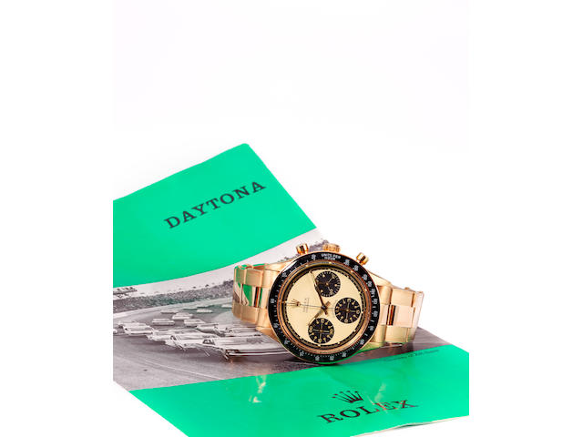 Rolex. A fine and rare 14K gold wrist chronograph and braceletCosmograph Daytona, Paul Newman model, Ref: 6241, Case no. 2084218, sold 1967