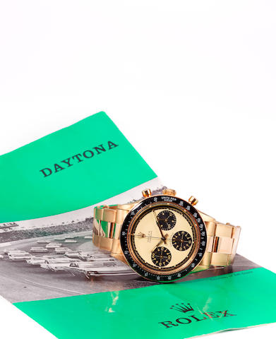 Rolex. A fine and rare 14K gold wrist chronograph and braceletCosmograph Daytona, Paul Newman model, Ref: 6241, Case no. 2084218, sold 1967