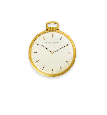 Vacheron & Constantin. A fine 18K gold open face dress watch and a 9K gold chainRef:6915, Case no.404810, movement no.573608, 1960's