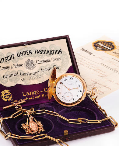 A. Lange & Söhne, Glashütte. A 14K gold hunter cased keyless lever watch and chainDeutsche Uhren-Fabrikation, no.88572, sold 1923