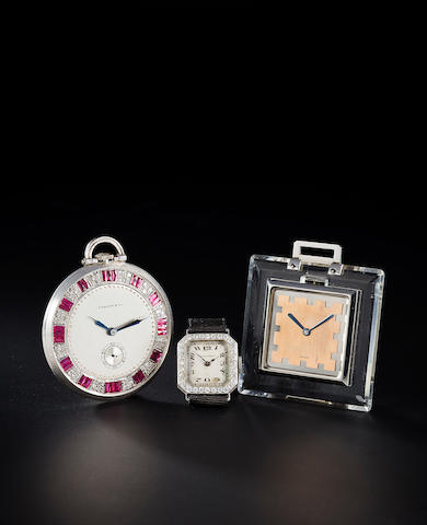 A ruby, diamond and platinum pocketwatch, Tiffany & Co. (crystal broken), with fitted box