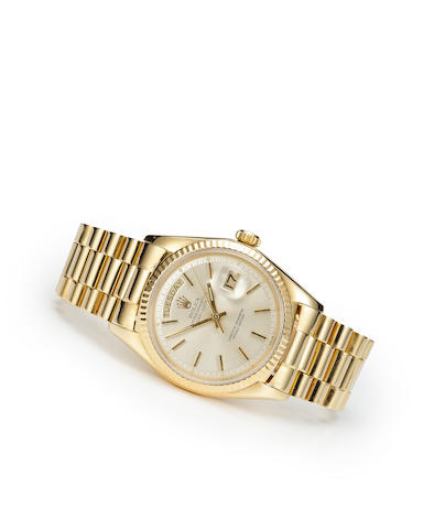 Rolex. An 18K gold automatic center seconds wristwatch with calendar and braceletOyster Perpetual Day Date, Ref:1803, case no. 1754022, circa 1965