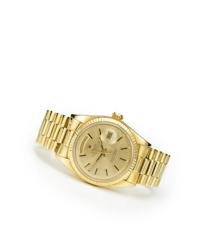Rolex. An 18K gold automatic center seconds wristwatch with calendar and braceletOyster Perpetual Day Date, Ref:1803, case no. 3675472, circa 1972