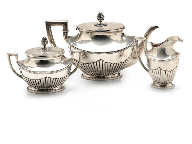 A German 800 standard silver three piece neoclassical tea set Koch & Bergfeld, Bremen, retailed by E. Marcus <br># 22571,-2 and -3