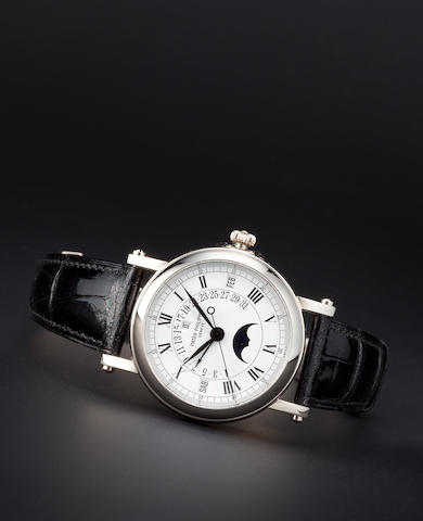 Patek Philippe. A fine white gold automatic center seconds wristwatch with retrograde perpetual calendar and moon phasesRef:5059G-015, Case no. 4066560, Movement no. 1958000, sold 1999