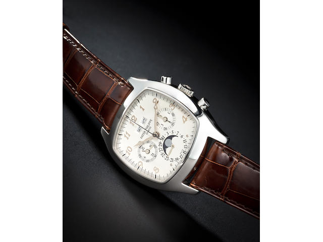 Patek Philippe. A fine and very rare platinum cushion-form perpetual calendar chronograph wristwatch with registers and moon phases and a spare diamond-set black dialRef.5020P, movement no. 3046055, circa 1996
