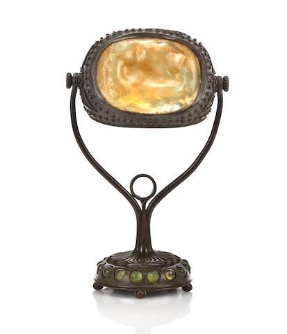A Tiffany Studios Turtleback tile, Favrile glass and bronze desk lamp circa 1910