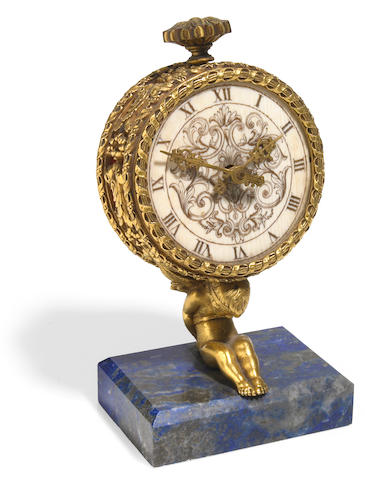 A gilt bronze, ivory and lapis lazuli desk timepiece <bR>probably E.F. Caldwell & Co.<br>late 19th century