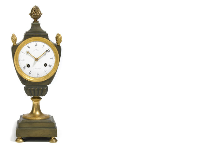 An Empire gilt and patinated bronze mantel clock <br>first quarter 19th century