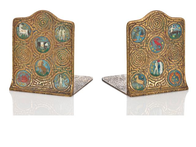A pair of Tiffany Studios enameled gilt-bronze Zodiac bookends 1899-1918