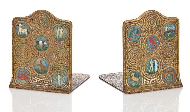 A pair of Tiffany Studios enameled gilt-bronze Zodiac bookends 1899-1918