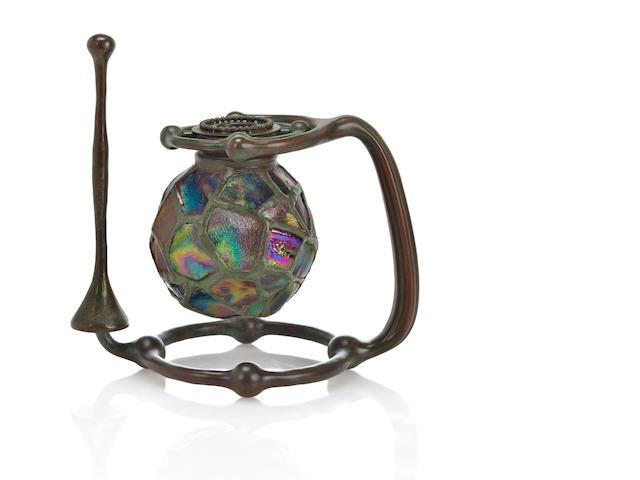 A Tiffany turtleback tile Gimbal candlestick